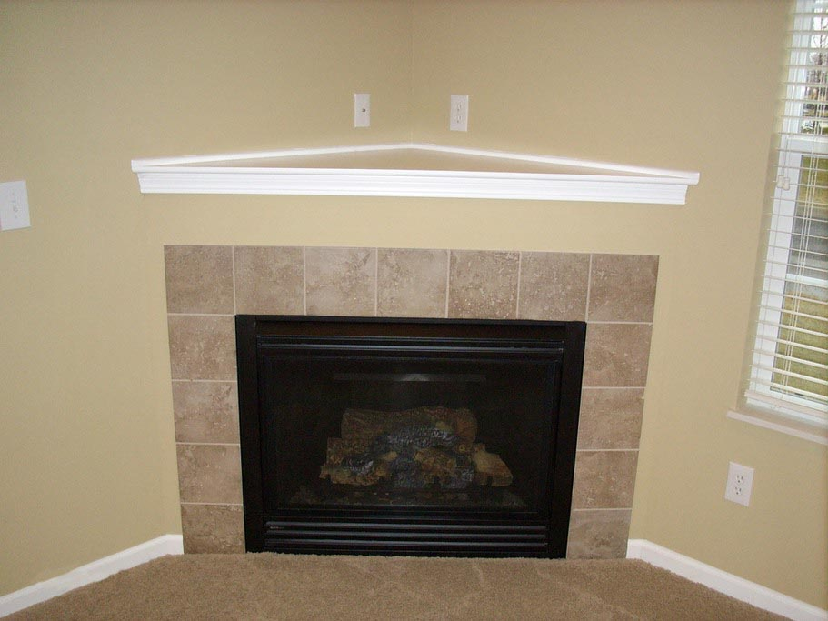 Corner fireplace mantels and surrounds fireplace designs for Building a corner fireplace