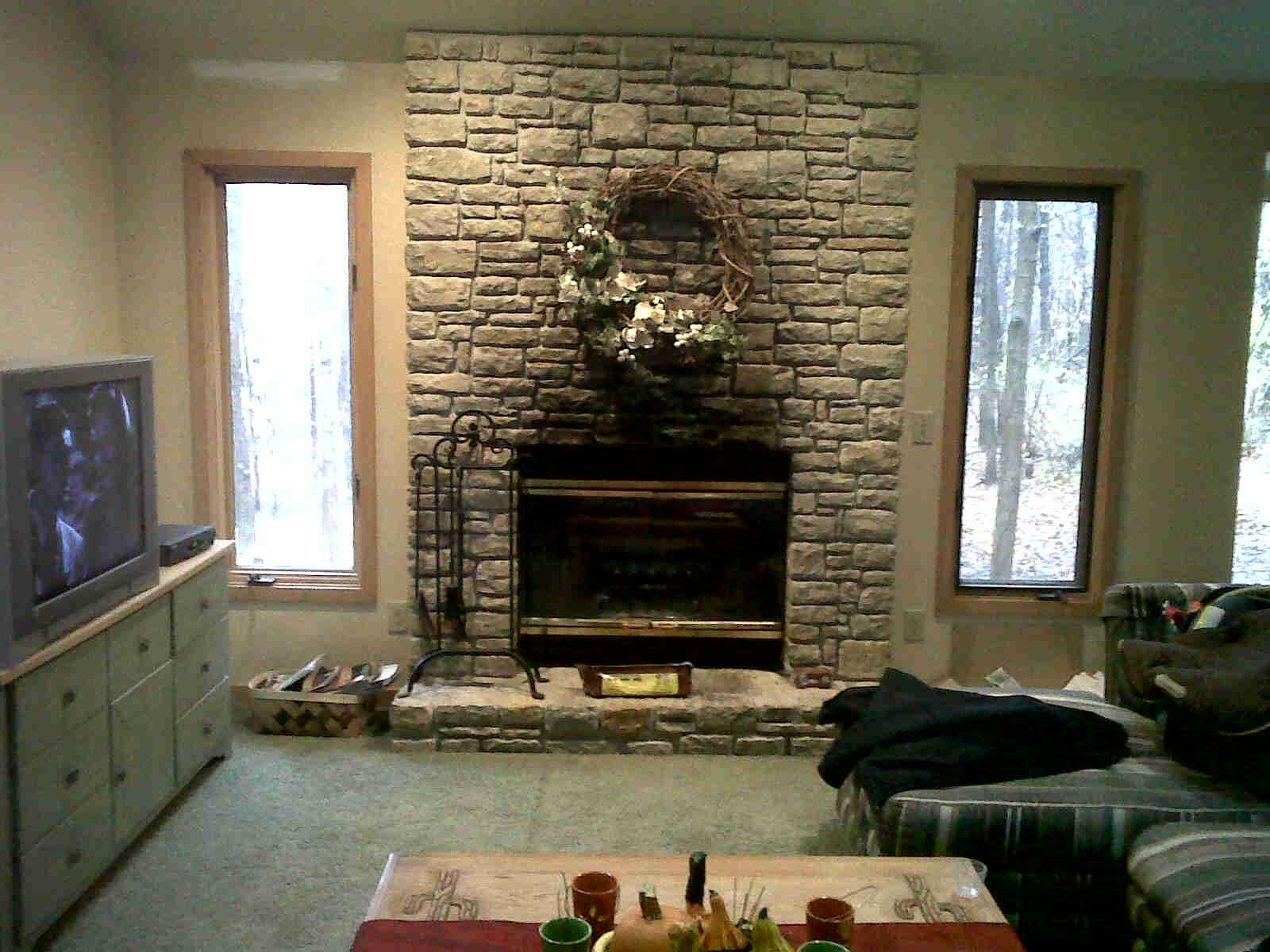 Faux stone fireplace mantels traditional fireplace for Faux marble fireplace mantels