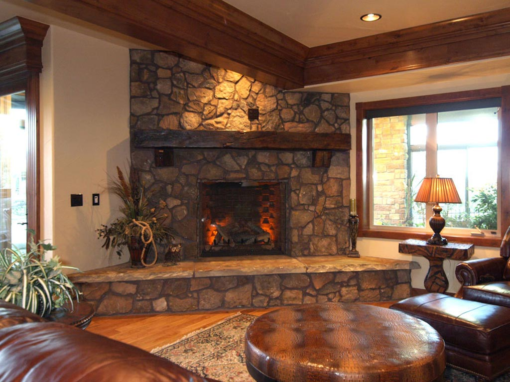 Indoor electric fireplace with faux stone surround for Interior fireplaces designs